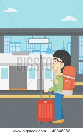 An asian woman standing at the train station on the background of train with open doors. Young woman with suitcase waiting for a train. Vector flat design illustration. Vertical layout.