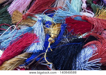 This is a photograph of colorful thread tassels