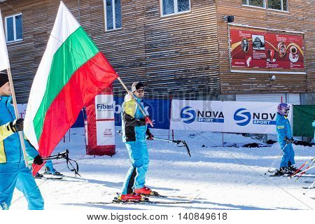 Bansko, Bulgaria - December 12, 2015: Opening new ski season 2015-2016 in Bansko, Bulgaria. Skiers with Bulgarian flag at slope