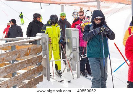 Bansko, Bulgaria - March 4, 2016: Ski resort, skiers entering ski lift at lift station in Bansko, Bulgaria
