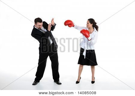 Woman in boxing gloves hitting businessman