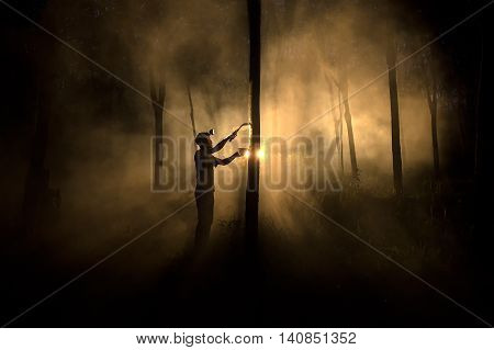 Man worker People working cutting Tapped rubber tree with knife at night