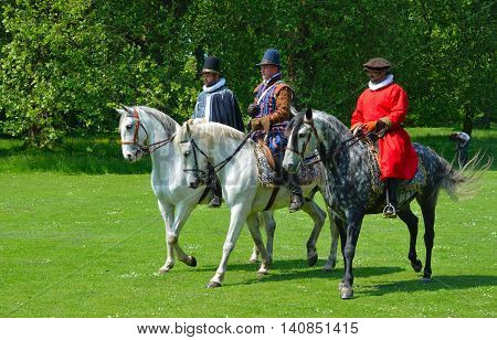 SAFFRON WALDEN, ESSEX, ENGLAND - JUNE 05, 2016: Three Grey horse  being  ridden by men wearing Elizabethan costumes.