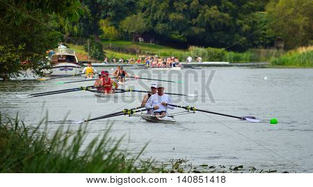 ST NEOTS, CAMBRIDGESHIRE, ENGLAND - JULY 24, 2016: Rowing on the River Ouse at St Neots on a sunny day.