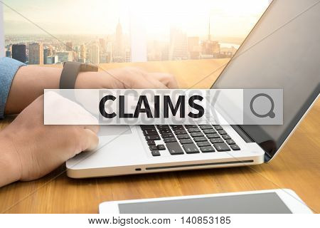 CLAIMS SEARCH WEBSITE INTERNET SEARCHING man and hand computer