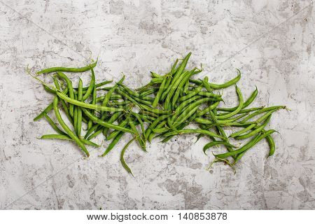 French bean on light surface close up top view