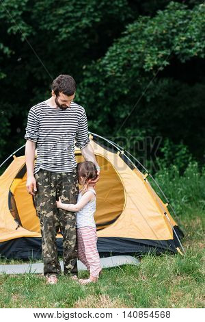 Shy girl with dad, travel photo, free space. Family trip, camping, pastime together concept