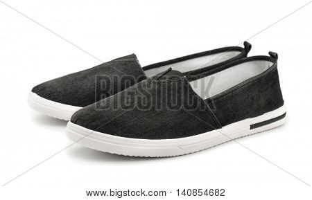 Pair of black canvas slip on casual shoes isolated on white
