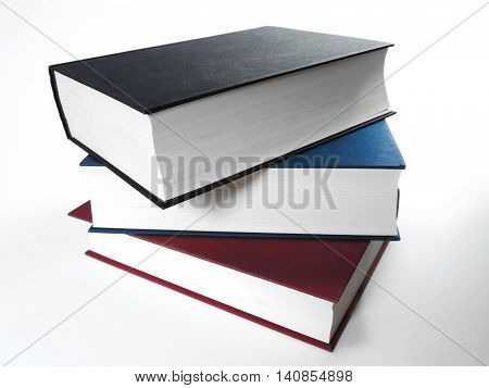 Book stack with colored books, studio shot.