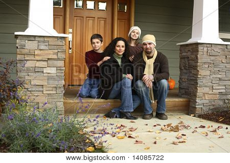 Family portrait sitting on porch