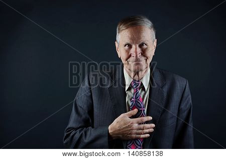 Happy Caucasian businessman isolated on black background with copy space