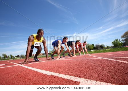 Track runners in starting position