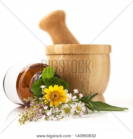 Alternative health care fresh herbal and Bottle of aromatherapy in mortar wooden isolated on white background