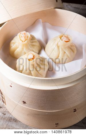 Prepared steamed dim sum with shrimps in a bamboo steamer