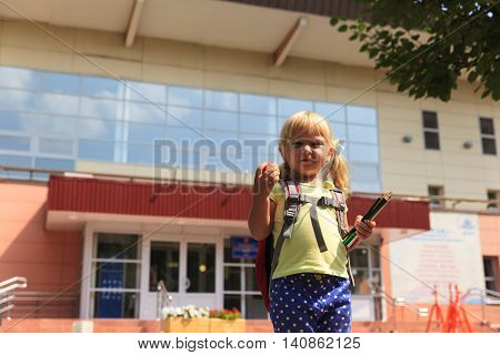 Back to school - cute little girl going to school or daycare