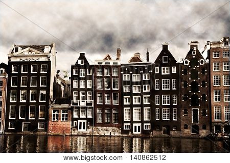 Amsterdam canal houses with a vintage sepia look