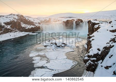 Godafoss waterfall during Winter at sunset. Iceland