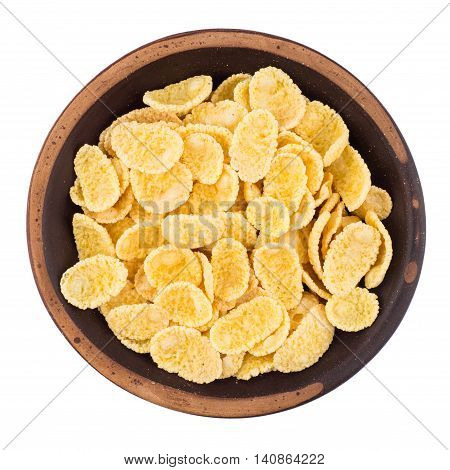 Cornflakes in a ceramic bowl isolated on a white background. Top view.