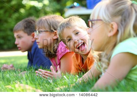 On boy looking at camera in group of kids