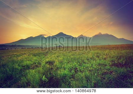 Summer sunset mountain landscape in vintage style. View from Nova Lesna village on the High Tatra Mountains Slovakia.
