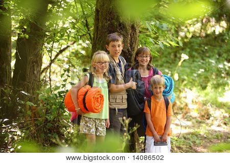 Group of kids outdoors with camping gear