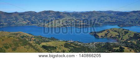 Akaroa Harbour and farmland. Scene on the Banks Peninsula New Zealand.
