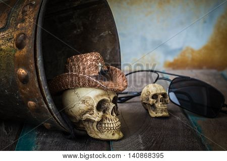 Skull cap on the water tank on the old wooden background.