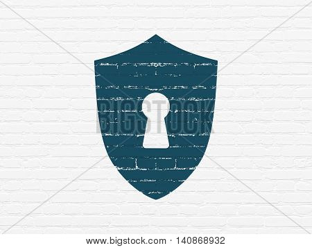 Safety concept: Painted blue Shield With Keyhole icon on White Brick wall background