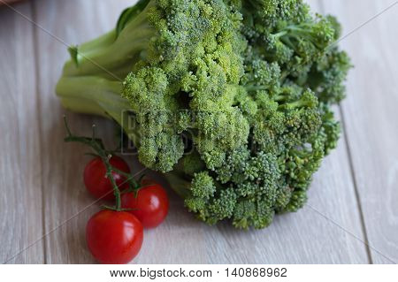 Fresh broccoli on the grey wooden table