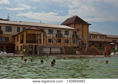 BEREGOVO UKRAINE - JULY 4 2015: In the pool with thermal waters in Beregovo. There is always a lot of people at any time of the year