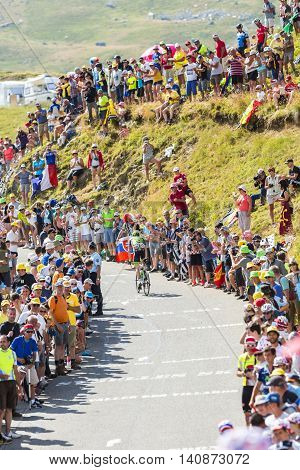 Col du Glandon France - July 23 2015: The Irish cyclist Daniel Martin of Cannondale-Garmin Team riding in a beautiful curve at Col du Glandon in Alps during the stage 18 of Le Tour de France 2015.