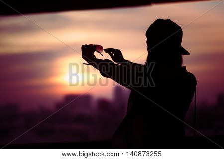 Girl Shooting Backlit Looking Through Solar Glasses