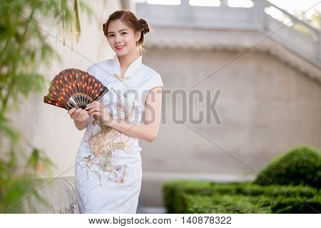 Asian Chinese Woman In Traditional Chinese .hold .fanning Paper