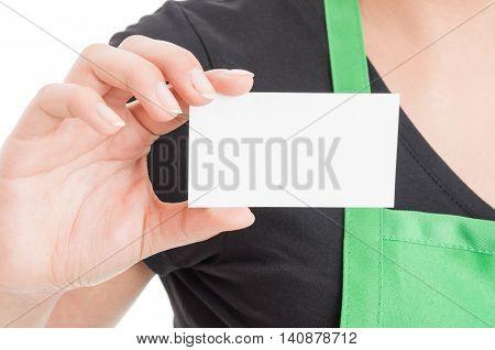 Closeup Of Business Card In Hypermarket Employee Hand