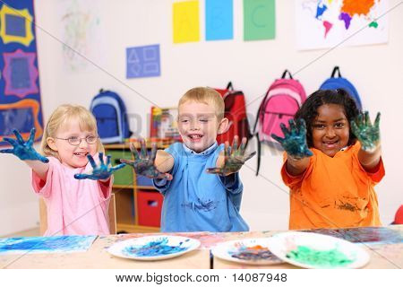 Preschool kids with paint on hands