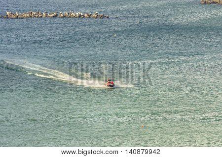 Mamaia Romania - July 18 2016: Tourists riding a jetski. Man on ski jet. Professional jet ski rider