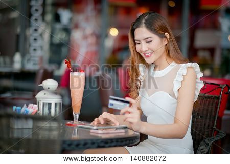 Woman Buying Online On Vacations With A Laptop .