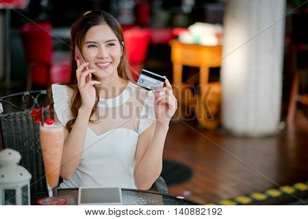 The  Businesswoman With Ipad And Credit Card