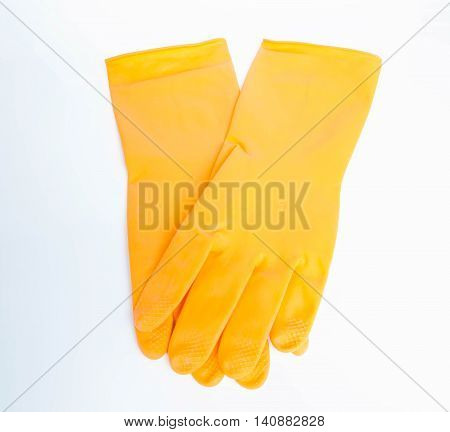 Wearing orange rubber gloves for cleaning .