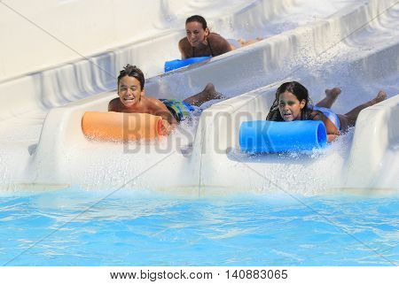 Rhodes Greece-July 15 2016: Family on the mat racer slide.Mat racer slide is very popular for young people in the Water Park. Water Park is located on the island of Rhodes in Greece and one of the most largest in Europe and is a very popular place