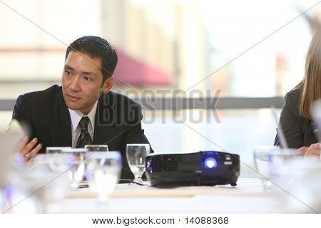 Businessman in board room meeting