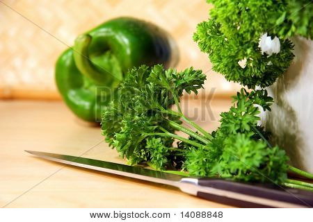 Chopping parsley and peppers for food preparation