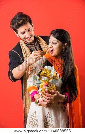 indian brother and sister enjoying and celebrating Raksha Bandhan festival