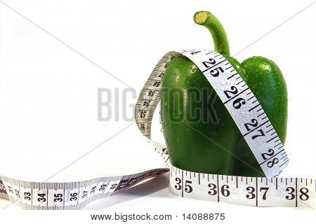 Measurement tape wrapped around green pepper/Concept for health, diet