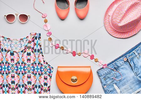 Accessories clothes fashion set. Stylish woman accessories, handbag clutch, top, denim, glamor orange shoes, trendy necklace, hat sunglasses. Fashion accessories. Summer outfit, accessories. Overhead
