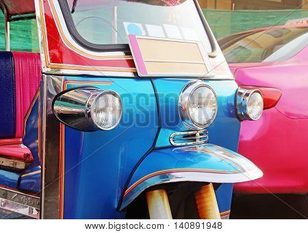Traditional Asian taxi - blue Tuk-Tuk urban vehicle