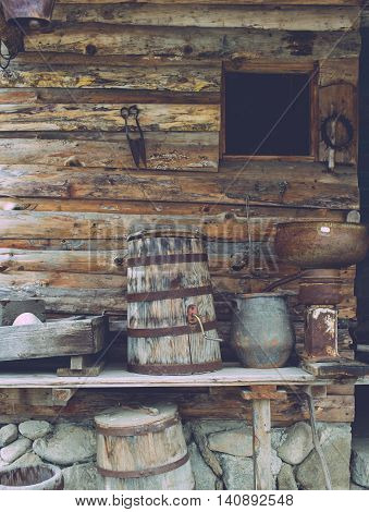 Old wooden house with tolls and wooden equipment