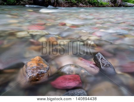 Water Rushes Past Exposed Rocks In Mountain Creek