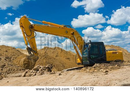 Construction scenery with an excavator in trench