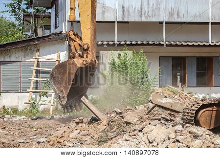 bucket  excavator destruction work outdoor dust soil in construction